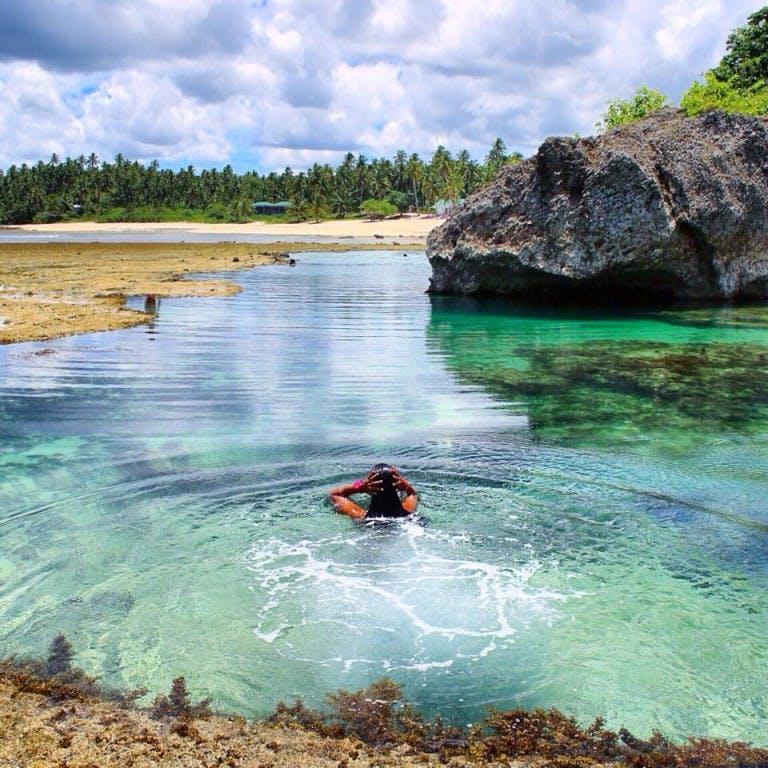 Taking a dip at the Mapupungko tidal pools