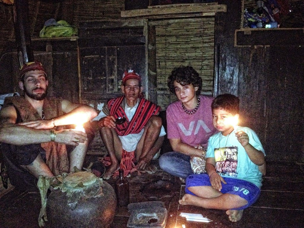 Inside the hut where the ritual has taken place. From left, Hetelekides' friend Ali Christophers, a local villager, Hetelekides, and Christophers' son Dimitri