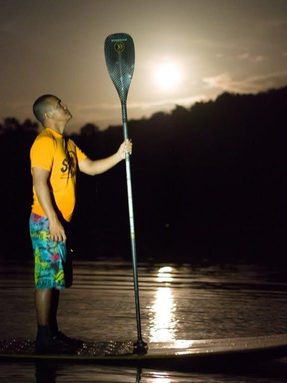 Professional paddler Buzzy Budlong organizes firefly tours along Abatan River