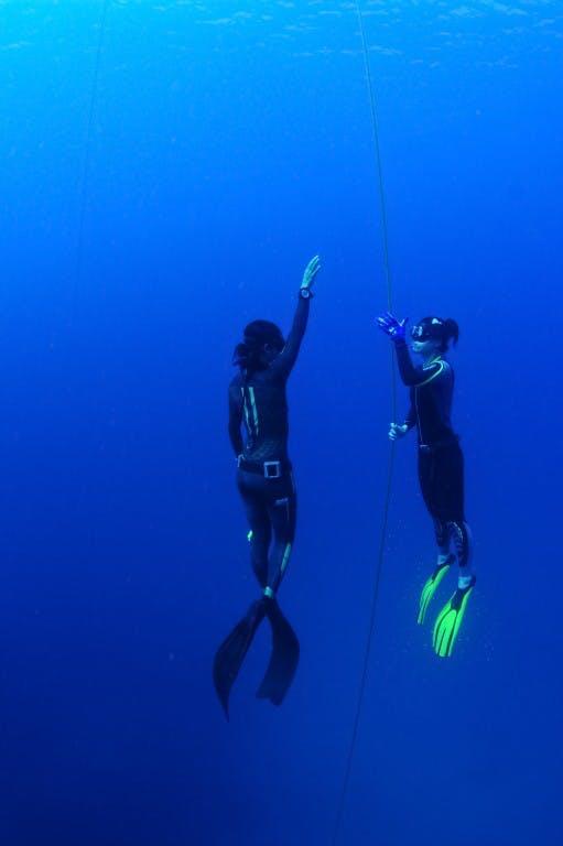 Lakambini LaRoque (left) teaching free diving