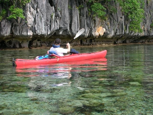 Kayaking across the crystal clear waters of Calamianes. Photo by Michael Barker, David Dalton, Wacky Gochoco, Tootoots Leyesa