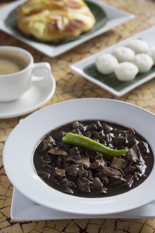 Dinuguan at puto or pork blood stew served with local rice cakes