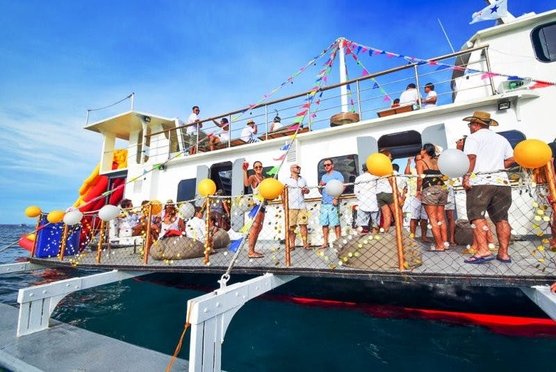 Partygoers enjoy the SunCruiser, dressed for the party by Ed Aniel
