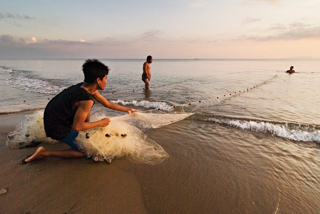 Fishermen hauling in their day's catch at Amazona Beach