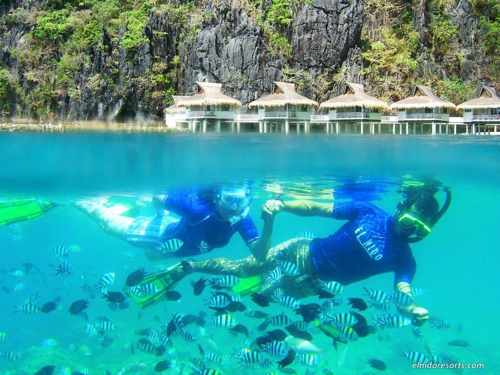 Snorkeling at Miniloc resort's house reef. By El Nido Resorts