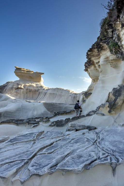 The magnificent limestone cliffs of Kapurpurawan. By Daniel Soriano