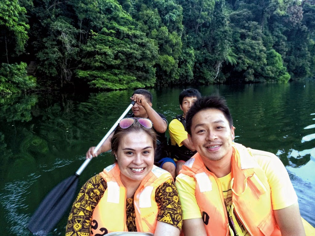 Writer Monica De Leon and local Nino Lee enjoying a scenic boat ride around the lake