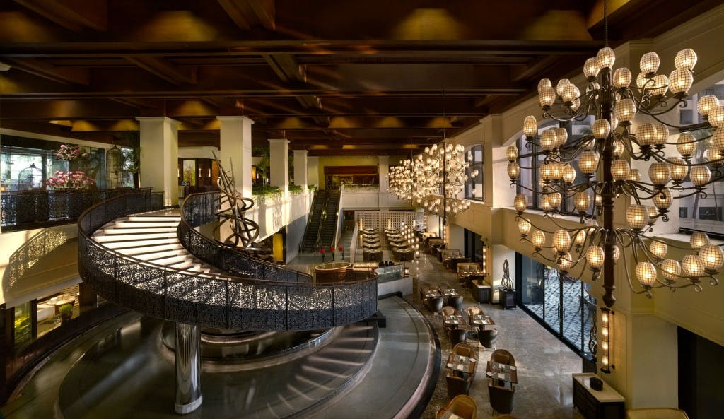 The lobby overlooks the grand staircase that dramatically leads to Spiral restaurant
