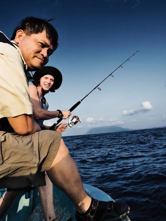 Chip Childers tries his hand at fishing. Photo by Ferdz Decena
