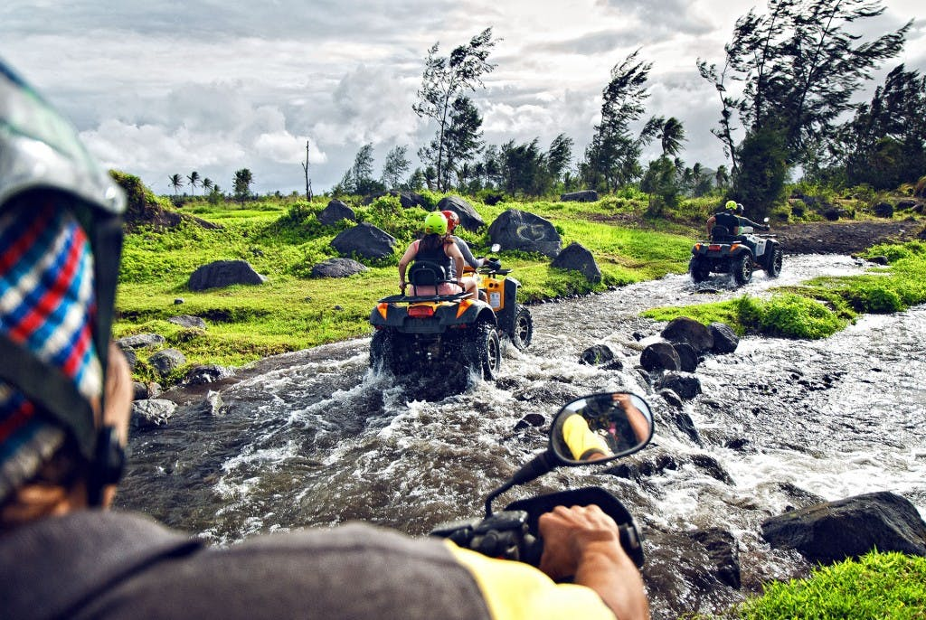 The exciting part of ATV rides up Mt Mayon includes passing through rocky streams