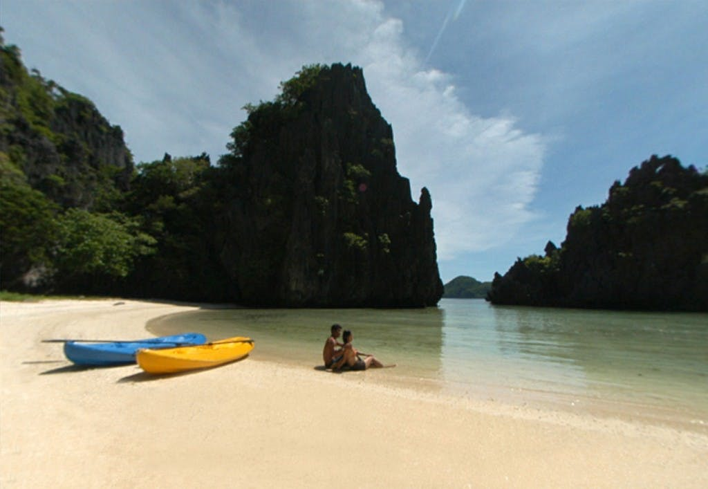 Kulasa beach, one of El Nido's sandy beaches enveloped by towering limestone cliffs. Photo by El Nido Resorts