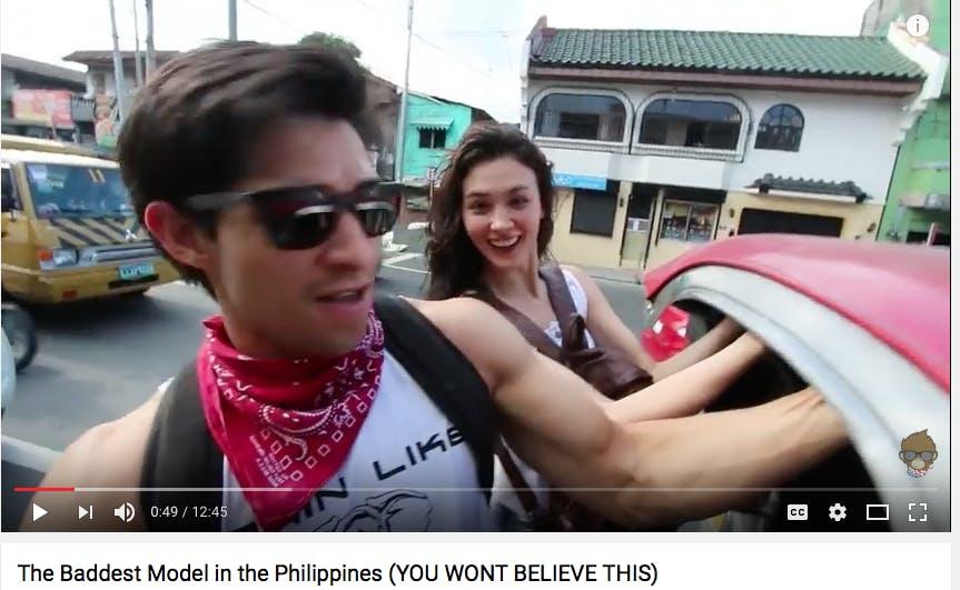 City commute on the wild side: Wil Dasovich and Coraleen Waddell hanging on the back of a moving jeepney