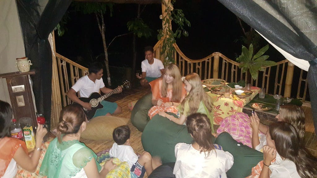 Guests enjoying a local music performance - one of Aetas Glamping El Nido's bespoke activities